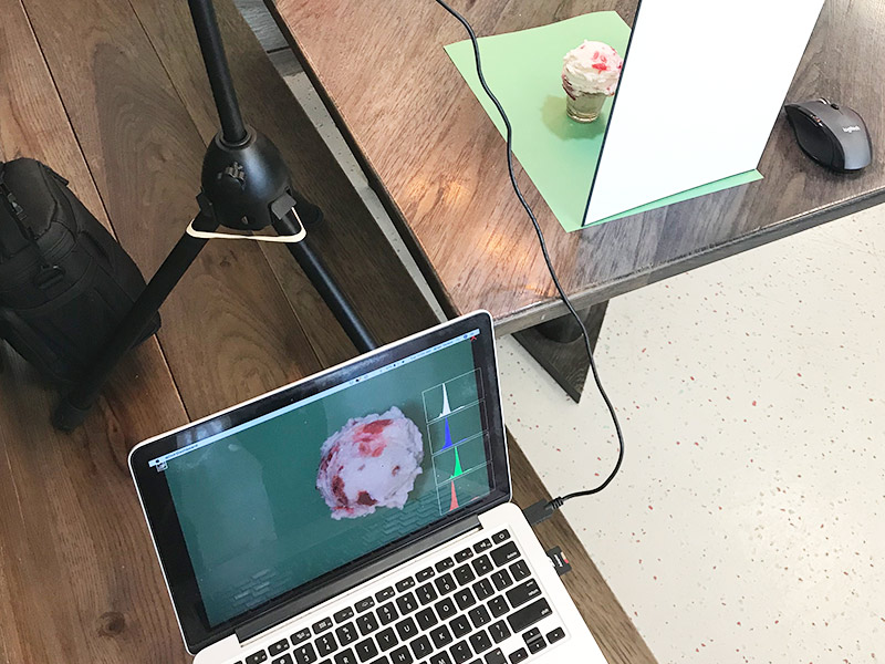 Photo of photography setup with laptop and ice cream